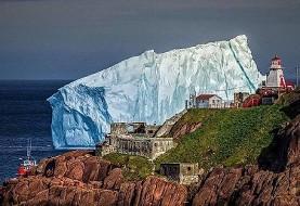 شگفت زدگی مردم از توده عظیم یخ بزرگ تر از کشتی تایتانیک در ساحل شرقی کانادا (ویدیو)