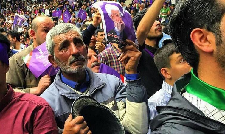 بدون تعارف با میوه فروش جانباز اردبیلی حامی روحانی که عکسش جهانی شد