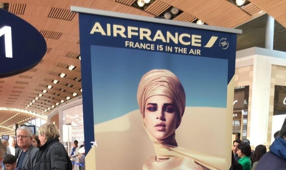 Air France displays veiled woman unveiling flights to Tehran
