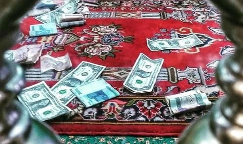 US dollar bills found among donations to small religious mausoleum ...