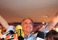 Ousted Caracas mayor flees house arrest, heads to Madrid