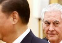 Smoothly but warily, U.S. and China stick to script in Tillerson visit