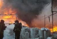 آتش سوزی گسترده درمحدوده میدان بهارستان