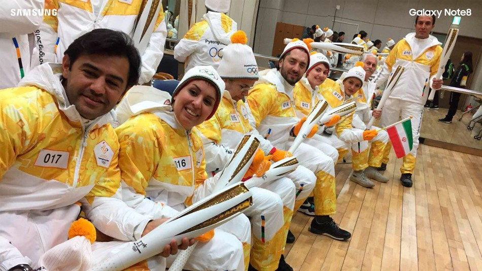 Ten Iranians and Two Robots Among 7500 Torchbearers of Winter