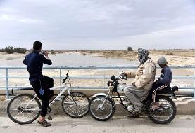 چشم های خشک سیستان تر شد! آب هیرمند به تالاب خشکیده هامون در افغانستان و ایران رسیده است