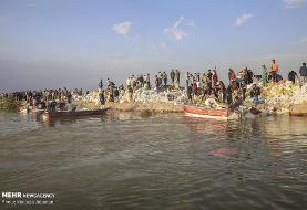مردم گلدشت اهواز همراه کمک های عراق ۴ مرتبه سیل بند را ترمیم کرده اند