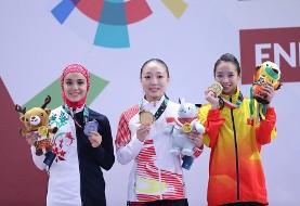 عکس پوشش دختر ۱۸ساله ایرانی اهل شهرکرد بعد از کسب مدال نقره بازی های آسیایی