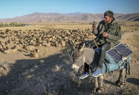 In Pictures: Shepherd in Turkish highlands checks news on solar-powered phone