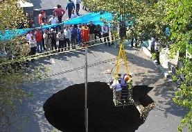 نشست زمین در خیابان آزادی یک کامیون را بلعید! عکس