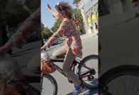 Iranian Woman Angers Islamic Clergymen by Riding her Bicycle Unveiled