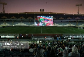 Iranian families, men and women, allowed to watch the match against Portugal on big screen in Azadi Stadium