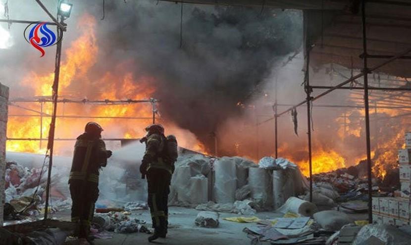 آتش سوزی گسترده ۲ ساختمان در میدان بهارستان