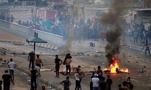 ترور مقتدی صدر همزمان با قتل عام تظاهرکنندگان در بغداد توسط مردان نقاب دار ناکام ماند
