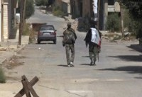 The Latest: Syrian troops advance toward IS-held border town