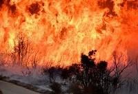 California wildfire rages, threatens communities