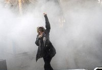Ten dead in overnight Iran unrest as Rouhani strikes defiant note