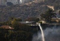 The Latest: Los Angeles fire reaches Rupert Murdoch winery