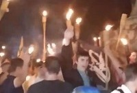 Torch-wielding white nationalists give Nazi salutes during University of Virginia protest