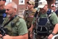 Militia force armed with assault rifles marches through US town ahead of white nationalist rally