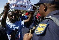 The Latest: South Africa grants immunity to Zim first lady