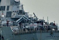Divers have located human remains in warship: US admiral