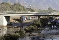 California highway to stay shut another week after mudslides