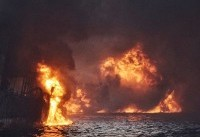 China races to tackle expanding oil spill after tanker sinks