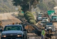 Major highway reopened as California mudslides toll climbs to 21