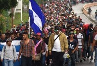 Honduran migrants defy Trump to continue long march north