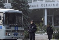 The Latest: Crimea hunts possible school attack accomplice