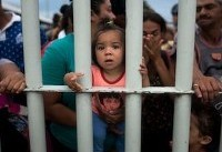Migrant caravan vows to remain on border crossing without food or water until Mexican ...