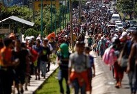 Trump vows to cut Central America aid, calls migrant caravan an emergency