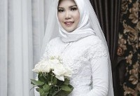 Woman wears wedding gown alone after fiance dies on Lion Air