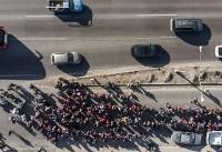Advance guard of caravan reaches U.S. border — and waits