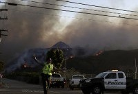 The Latest: Wildfire triggers evacuation order for Malibu