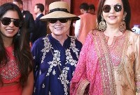 Who is Isha Ambani, and why are Beyoncé and Hillary Clinton in India for her wedding?