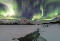 Aurora borealis turns the sky greener than the ground