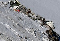 Iran teams carry plane crash dead down from mountain