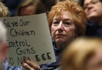 Colorado congressman booed as people demand action on guns