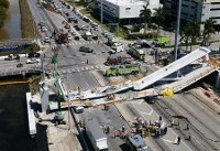 The Latest: University head laments fall of campus bridge