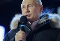 The Latest: Putin dodges question about future elections