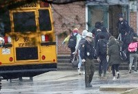 The Latest: Girl in critical condition after school shooting