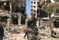 The Latest: Syrian TV: Air defense confront missiles in Homs