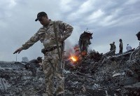The Latest: Putin denies Russia responsible for MH17 downing