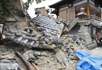 The Latest: More than 210 injured in Osaka-area earthquake