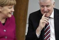 The Latest: Seehofer wants quick action on migrants