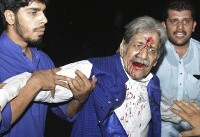 The Latest: Death toll leaps to 128 in Pakistan bombing