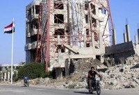 Syria rebels surrender heavy arms in Daraa city: state media