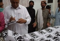 Pakistanis mourn after election rally bombing kills 128