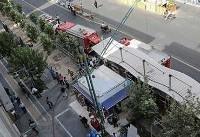 جزییات آتش سوزی یک ساختمان در چهارراه ولیعصر تهران +تصاویر